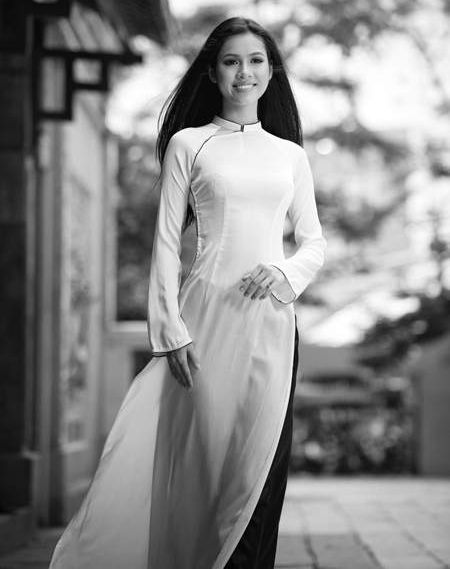 White ao dai with a colored brim and colored pants to accent it