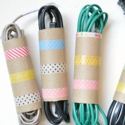 Great idea: Use your empty toilet paper rolls and some washi tape to organize those tangled cords.