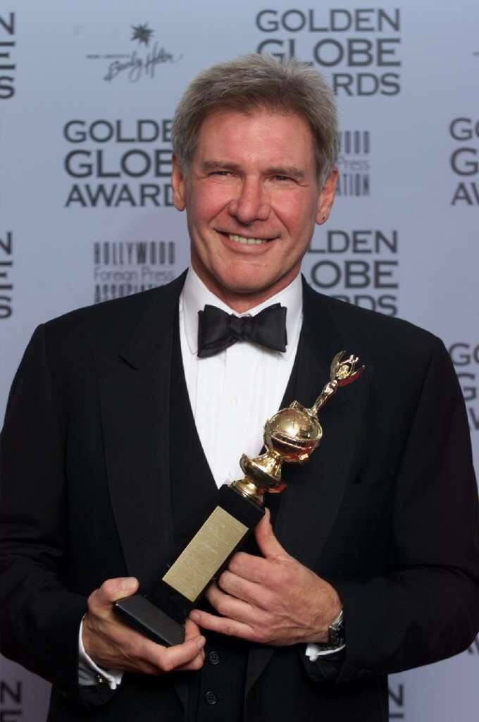 Harrison Ford receiving Golden Globe Award