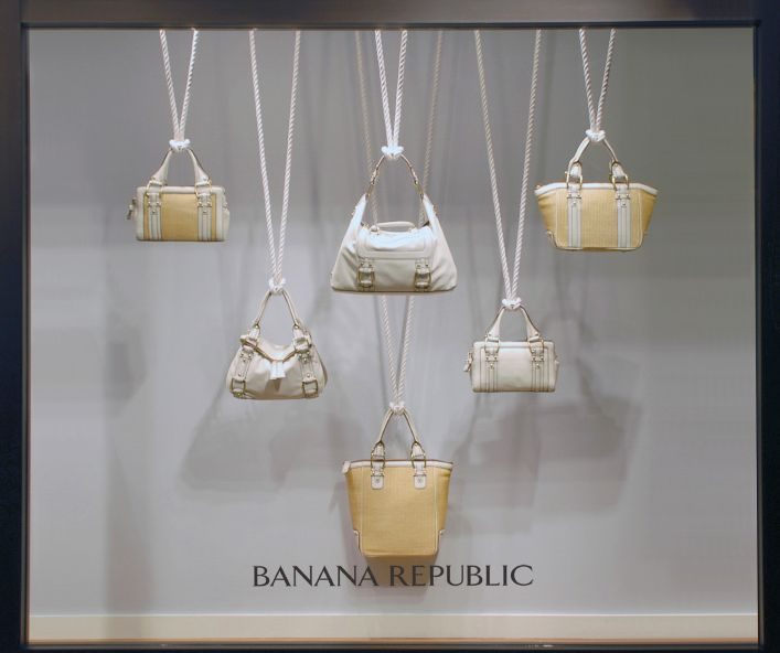 Banana Republic window display beautifully hangs purses.