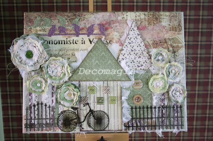 Canvas with decoscrap, flowers and chipboards