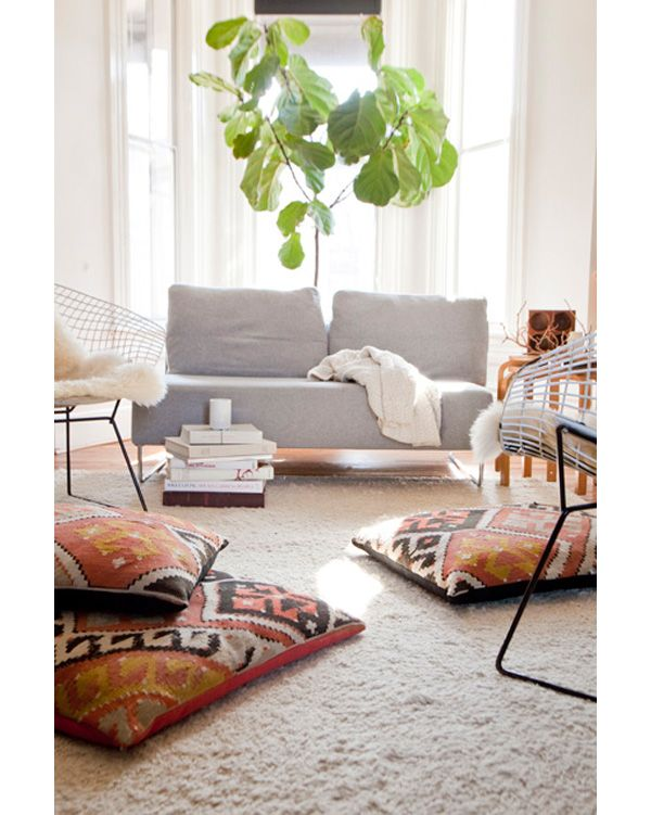 arm-less sofa + patterned floor pillows + fiddle leaf fig tree