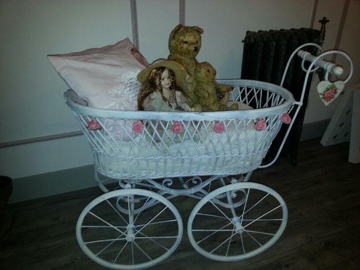 Bought this antique pram  and  painted it..