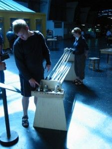 Downhill Race Galileo demonstrated that all objects will fall at the same rate (with the same acceleration) regardless of their weight. Downhill Racer demonstrates that not all round objects roll at the same rate, even if their weights are identical. The rate of acceleration of a rolling object (angular acceleration) depends not only on its mass, but on how that mass is distributed. This exhibit allows visitors to try rings, disks, edge and center-weighted disks on a smooth, gentle slope.