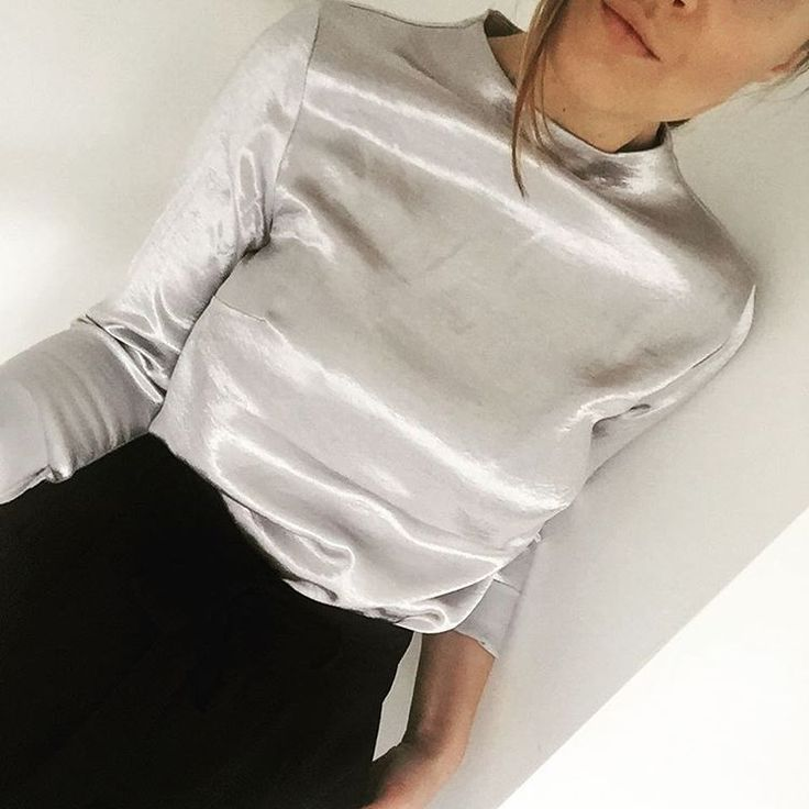 Futuristic metallic silk top from H&M in silver and black culottes from Zara. Relax tailoring with a feminine silk top to create a effortless chic style for day one of LFW.