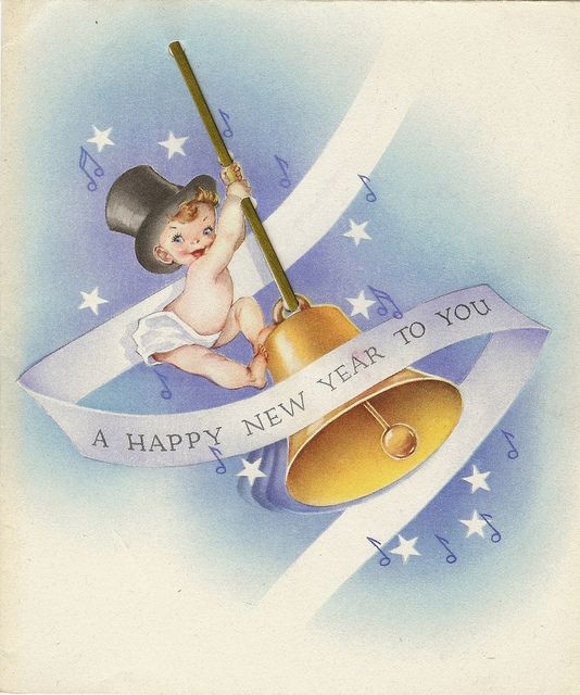 New Year Baby ringing bell.