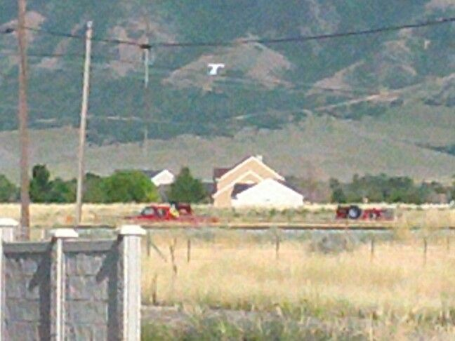 Tooele fire department on the grass fire