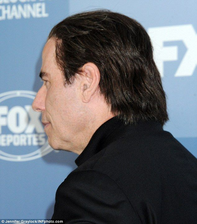 So folli-cool! John Travolta showed off his layered mullet while attending theannual Upfront Presentation Post Party hosted by television network Fox in New York on Monday night