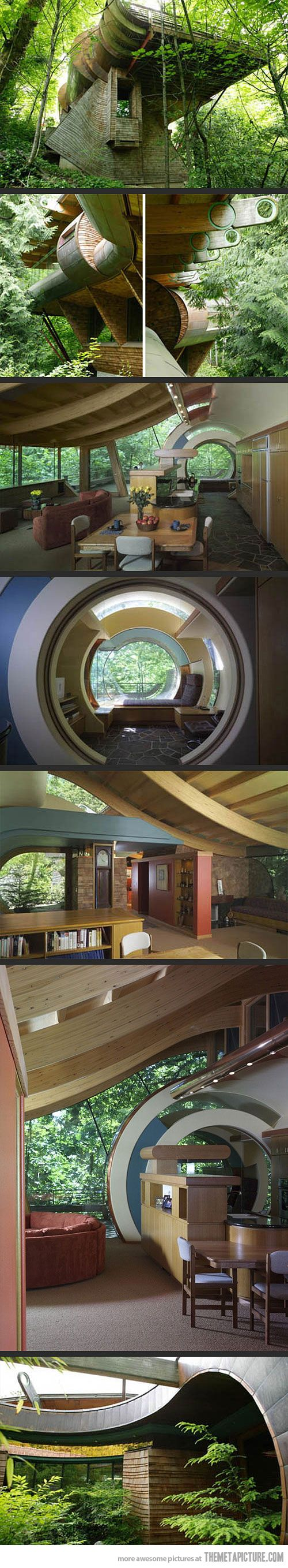 Wow ... I love how the architect has seamlessly integrated the structure into its surroundings.  I imagine that it would be like you were living in a treehouse ...
