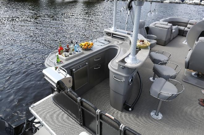 The island bar of the Grand Entertainer takes up about a third of the back of the pontoon boat that also has cocktail tables and chairs with...