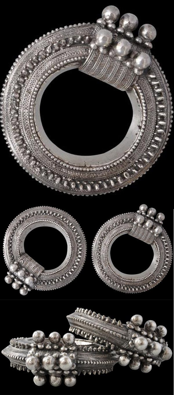 Yemen | Pair of silver upper arm bracelets ~ 'Damia' ~ hollow-cast silver. Worn by women in the Mahwit Province | 19th century | sold