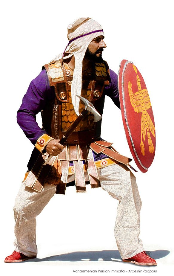 This is a representation of an Achaemenian Persian Immortal wearing the Anatolian style armor. Persian Immortals used many different styles of weapons and Shields.  In this case, we see the small round hoplon style shield, made of wood lamenant, covered in fabric, the Immortal is using a Sagaris battle axe and wearing the famous tiara Scythian style headress.  This particular Persian Immortal is representative of those who fought in the Persians Wars of King Darius and King Xerxes.