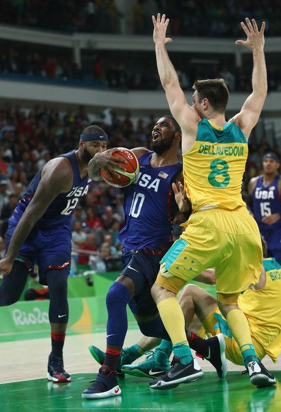 Matthew Dellavedova Photos - Kyrie Irving #10 of United States drives against Matthew Dellavedova #8 of Australia during the Men's Preliminary Round Group A game between Australia and the United States on Day 5 of the Rio 2016 Olympic Games at Carioca Arena 1 on August 10, 2016 in Rio de Janeiro, Brazil. - Basketball - Olympics: Day 5