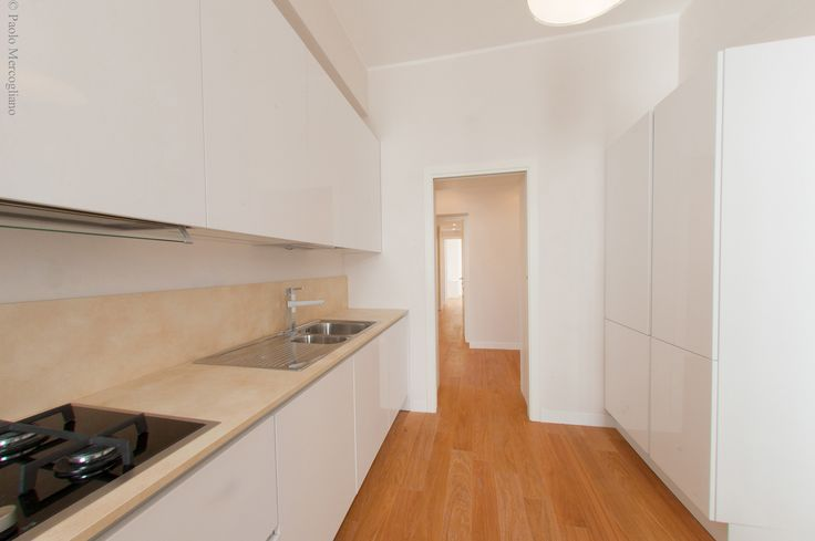 Kitchen: Perspective view towards the hallway with the private dwelling area