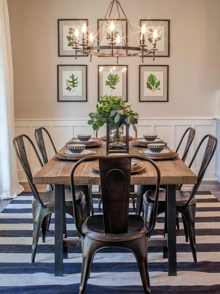 The footprint of the original dining room was actually reduced somewhat to allow the expansion of the kitchen. The space still feels roomy and well suited for entertaining. Joanna added a farm style table, industrial metal chairs and botanical prints in simple black frames.