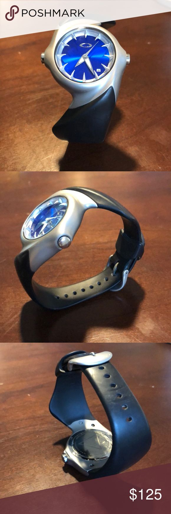 Men's Oakley crush watch Oakley crush watch. Black rubber band, silver body and blue face. Excellent condition, watch will need new battery. Oakley Accessories Watches