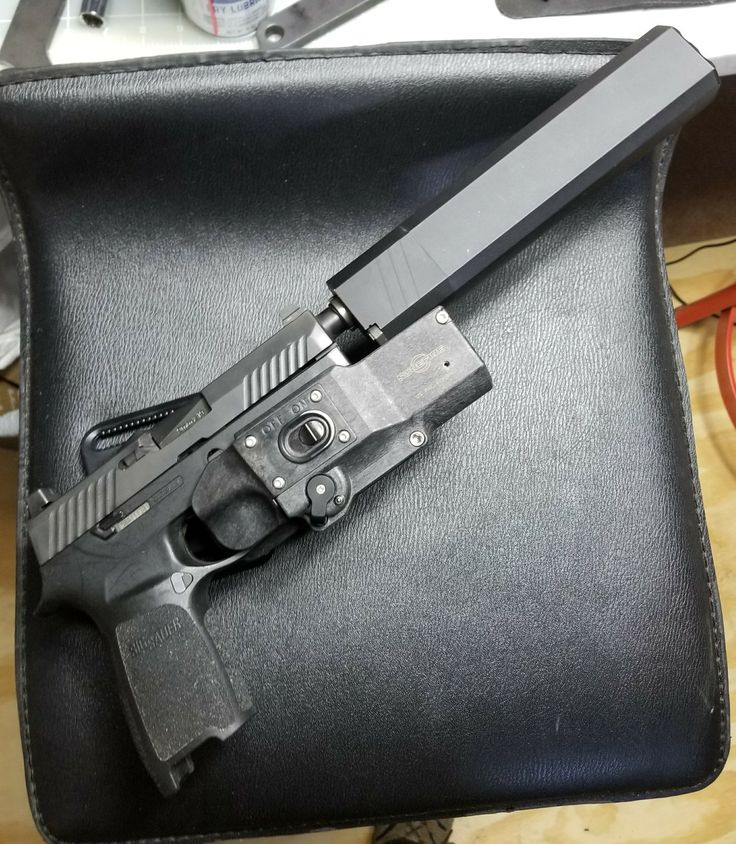 Sig Sauer P320 TACOPS with Apex trigger and Silencerco Osprey 45. Has Surefire X300UH that works with MasterFire holster.  Good retention and smooth draw. That holster is a keeper.