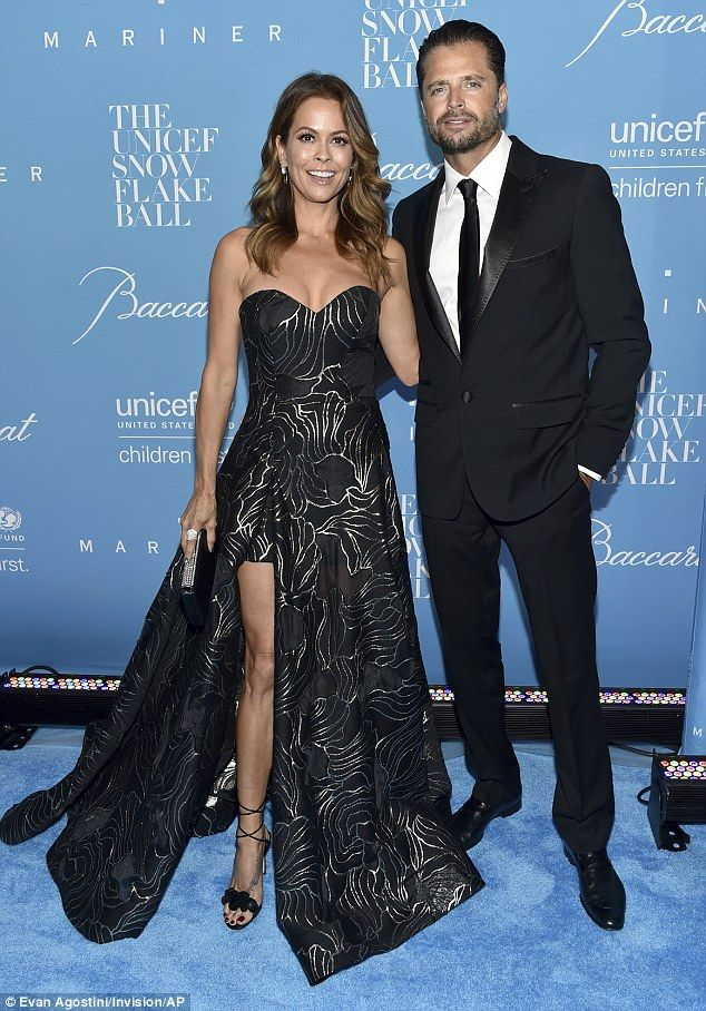 Good looking couple: The 45-year-old was joined at the black tie affair by her husband David Charvet