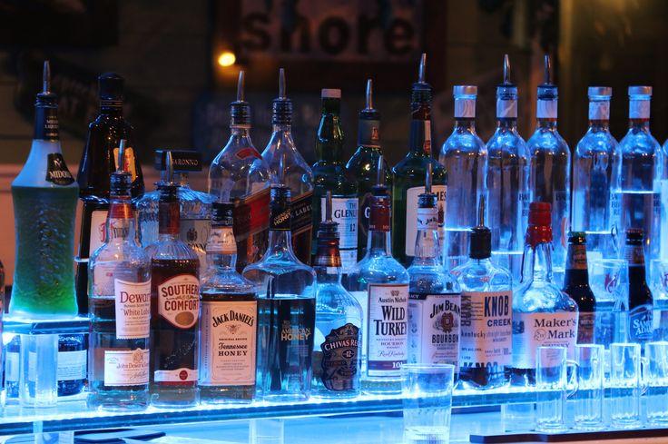 https://flic.kr/p/qfz8by | Blue Light Bar | Blue lights illuminate a restaurant bar at night in downtown Stuart, Florida.