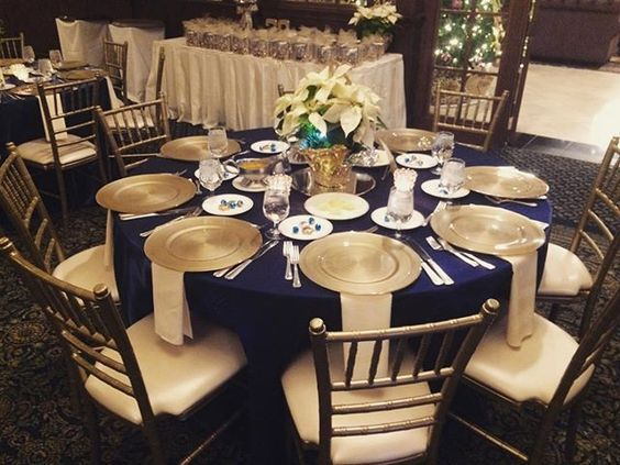 Royal blue Navy Blue and gold wedding table setting. So royal and sophisticated looking! We loved this beautiful wedding at the Drake Oak Brook in IL! To book top notch wedding entertainment sure to get your party started, check out www.felixandfingers.com today!
