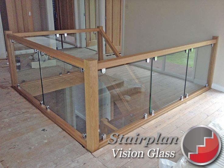 Vision Glass Balustrade Panels with oak handrail and glass clamp fixings