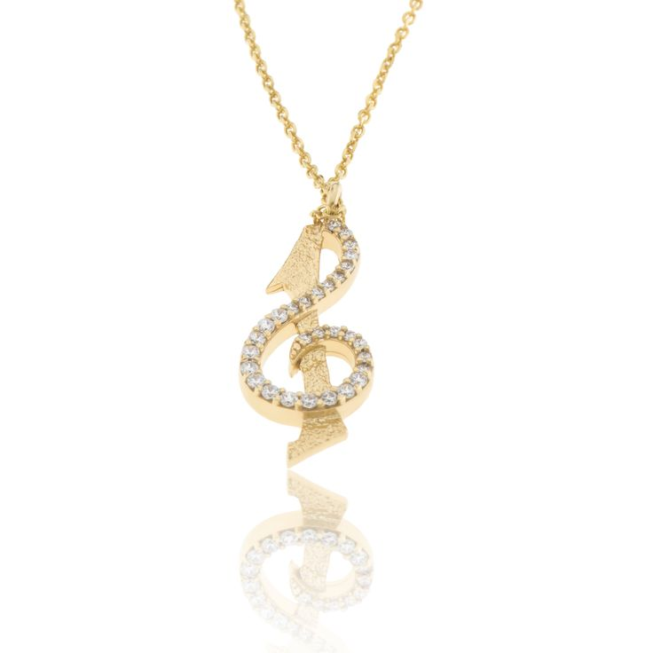 2016 Gold plated sterling silver charm with cubic zirgonia and a cord. Dimensions: 12 Χ 29 mm. Γούρι 2016 παντατίφ σε ασήμι 925 επιχρυσωμένο με λευκές πέτρες σε κορδόνι. Διαστάσεις : 12 Χ 29 mm