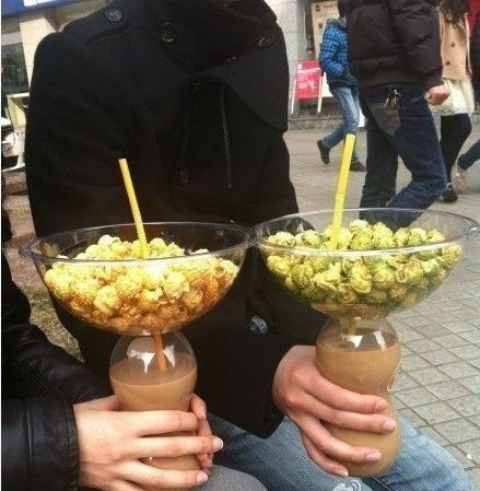 how do you carry your drink when you eat popcorn?