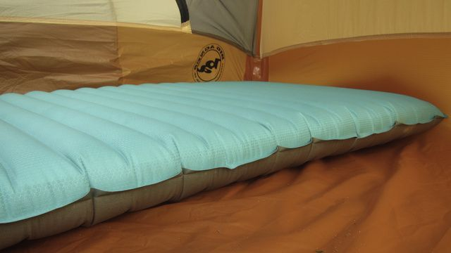 I can't prove it, but I'm pretty sure this thing is magic. It's the most comfortable backpacking sleep pad I've ever used by a tremendous margin. It's two and a half inches thick, it has an R-value of 4.9 (which means it provides incredible insulation), and weighs only 19 ounces. Inside, over a hundred triangular barriers reflect heat back to your body, with no bulky padding added, so it packs down to almost the size of a Nalgene bottle.