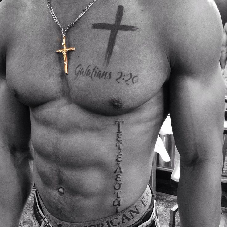 "top tattoo: Galatians 2:20 with brushstroke cross bottom tattoo: ""It is finished"" in Greek"
