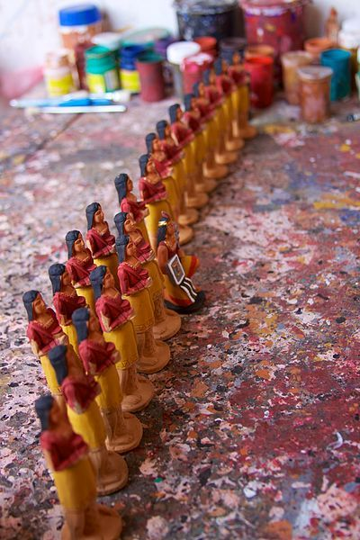 Handmade and painted Incan-figure chess pieces for being made for sale in the Pisac market