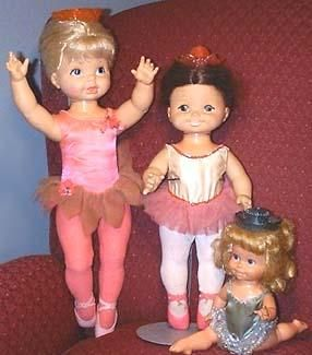 "1969-1971 Dancerina, 12"", 16"", or 24"" tall, dancing doll in pink tutu tallest one 24"" on the left in photo, all are battery operated dolls.    1969 Dancerella, 18"" tall, is shown in middle of photo, wearing a white and pink tutu, red plastic crown when pulled the doll danced.    1972 Baby Dancerina, 11-12"" tall, wears the green and silver tutu, in photo at bottom right, doing the splits."