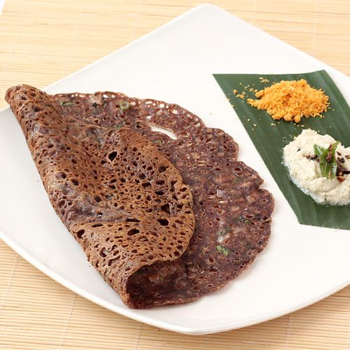 Ragi (Finger Millet) is a nutritious grain which is staple food in most of the South Indian states. This easy and instant step by step photo recipe of ragi dosa is all about how you can make this crispy and healthy south Indian style bread or crepe from the simple mixture of ragi flour, rice flour, yogurt, water and spices in just few minutes.