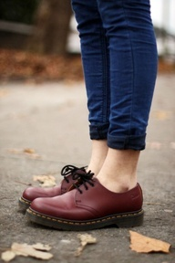 red doc martens shoes, blue jeans
