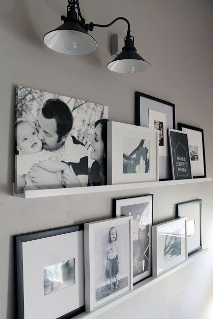 Photo Ledges O Fun - love the mixture of canvas with framed art and photos...for the living room ?