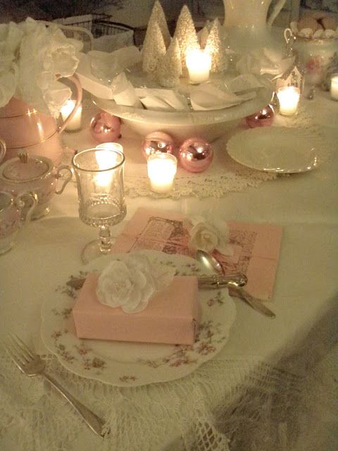 Love the lighting! Could easily be tweaked to become a wedding table setting with parting gift beneath the flower. I would love to keep the idea of a flower on top of each table setting.