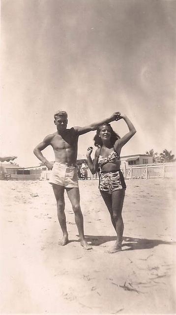 1950s couple man woman beach fit attractive athletic