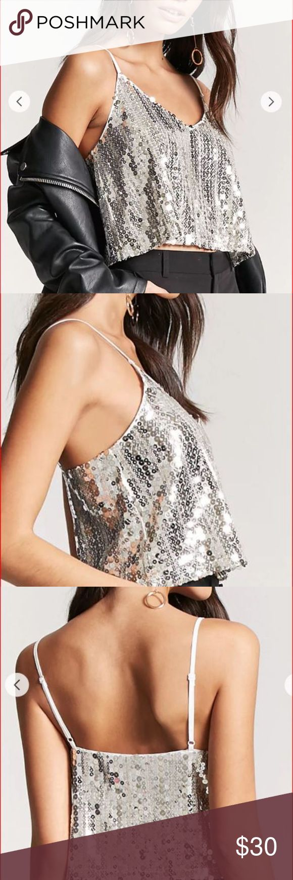 """Luxe Silver Round Sequins Crop Camisole A cropped cami top featuring an allover metallic silver round sequins on white background, adjustable straps, V-neck, and a drapey silhouette.  Wear with jacket, blouse etc or alone.  Gorgeous!  Can be dressed up or down.  Model wearing black dress slacks, looks just as amazing with jeans!   -100% polyester  - Hand wash cold  Bust 38"""" to 39"""" Tops Camisoles"""