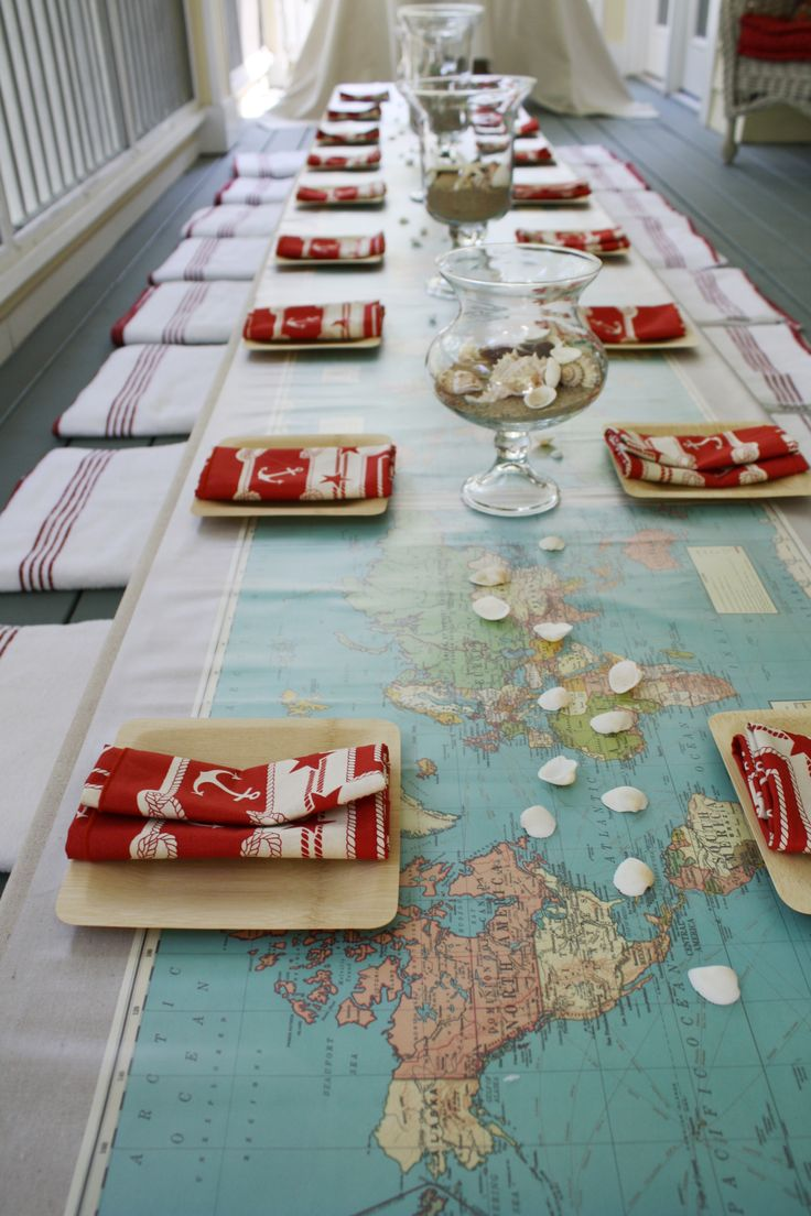 Sailboat Party: Low table covered with painting dropcloth, then paper maps, then sheet of frosted vinyl for durability.  Towels for wet little guests to sit on.