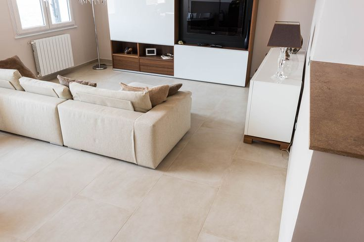 private villa in Sicily using its most prestigious Made in Italy porcelain tiles . Traditional and contemporary style with a cement look characterise the living room, paved with the One collection, a porcelain tile surface with soft and engulfing shades that offers spaces a sense of warmth, naturalness and elegance. #tiles, #MadeInItaly, #CaesarOne