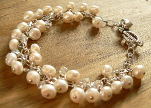 Freshwater Pearl and Swarovski Crystal Charm Bracelet Clutch and Clasp, http://www.amazon.co.uk/dp/B001L2WOAK/ref=cm_sw_r_pi_dp_sQodtb0DDQ5C9 £80.00
