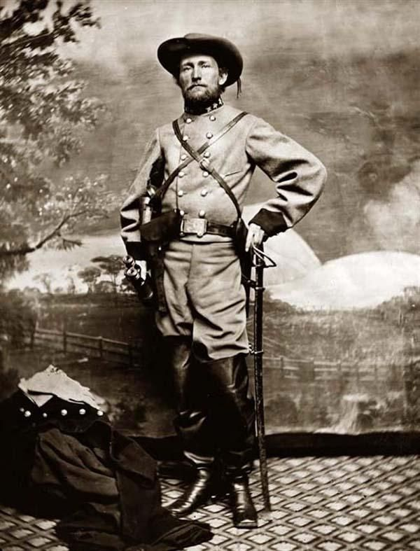 John Mosby, the Grey Ghost and legendary leader of the notorious Mosby Raiders. The group disbanded at the end of the war, but never surrendered. Years later after the War, Mosby would often entertain a young neighborhood boy with stories of his gallant Civil War exploits and his daring raids and they would often play war games in the yard together. That young boy grew into the man - George S. Patton.