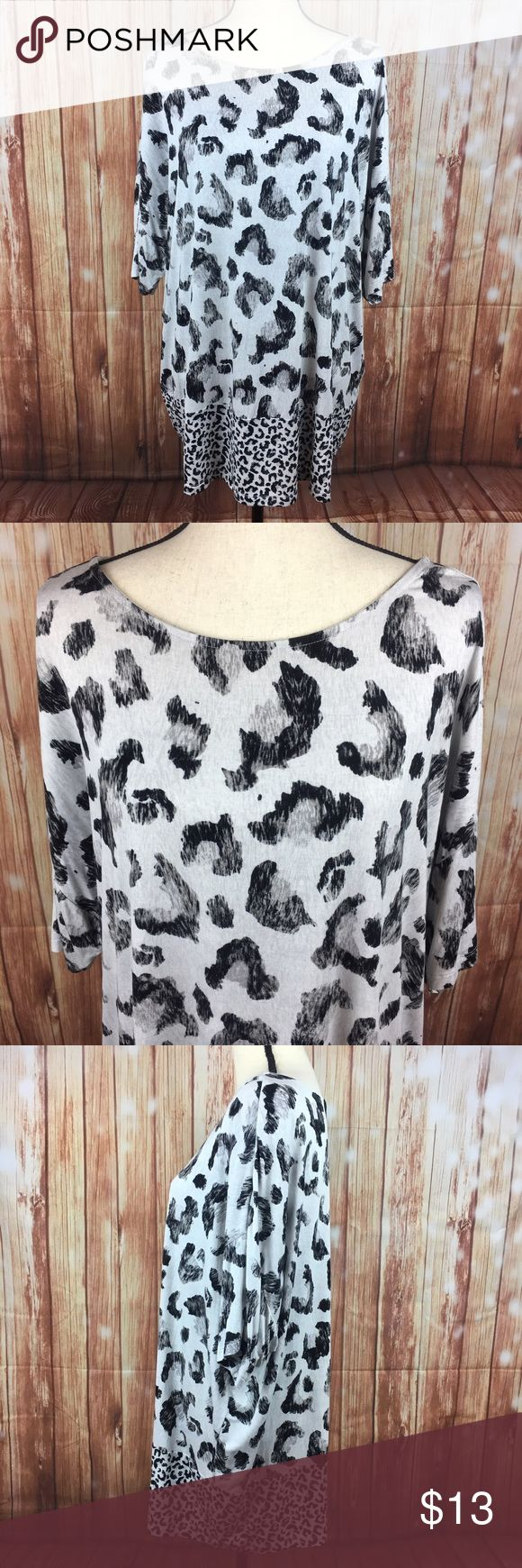 """Christopher & Banks Gray Black Leopard Print Shirt Size: Women's Extra Large Brand: Christopher Banks Condition: Excellent, pre-owned  Black & gray leopard print top.  Dolman sleeve. Bateau neckline.  Fabric: 95% Rayon, 5% Spandex Measurements: 28"""" bust from underarm to underarm 28"""" length from shoulder to hem  24.5"""" width at hem, laid flat Christopher & Banks Tops"""