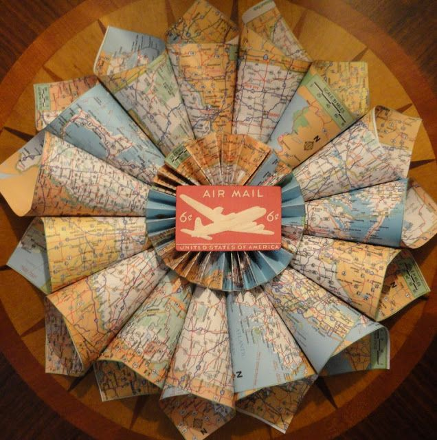 Map Wreath {by Haverford House}  Cut out each of the maps, rolled them up and glue them all together.