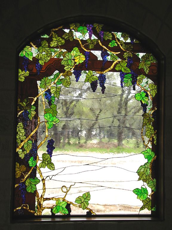 Grape vines on a trellis stained glass window