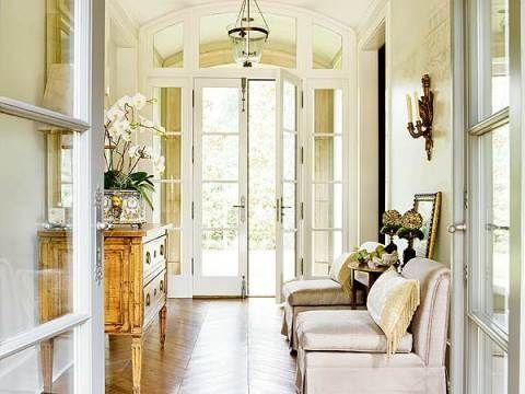 Glamorous foyer, love the floors!
