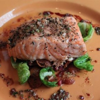 Slow Roasted Salmon ith Brussels Sprout Leaves, Bacon And Cilantro