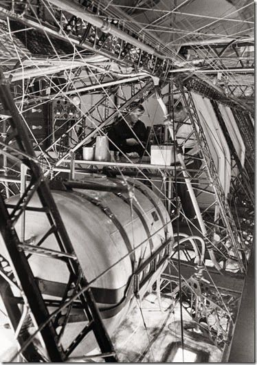 Robert Moser (dark shirt) and another crew member at an engineering work station in the Hindenburg. The keel walkway can be seen along the extreme right edge of the photo.