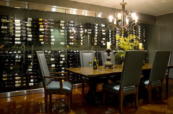 Wine wall dining room. I'm pushing to have this in our house.