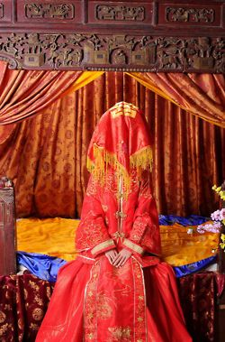 RED--RED ---RED!!!  Gorgeous traditional Chinese Wedding. Put away western white and get out Chinese red for Good Luck and a long, happy marriage.  Even the bride's veil is red.