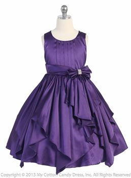 Purple Ribbon Sashes Flower Girl Dress, center pleated bodice ribbon sashes accent waist line. Falls into elegant ribbon skirt. Perfect for the holiday season. Available in Burgundy, Fuchsia, Purple as pictured, and Red Flower Girl Dresses.